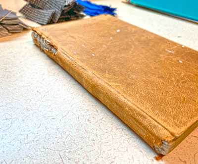 A leatherbound book from 1861 was donated from a private collection for testing. Photo courtesy of Battelle.