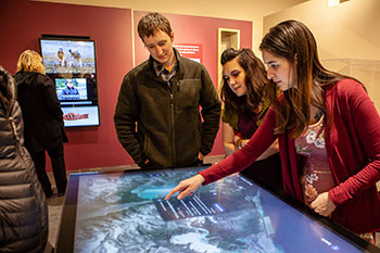 "Visitors use the interactive map at the Sealaska Heritage Institute's exhibit ""Our Grandparents' Names on the Land""."