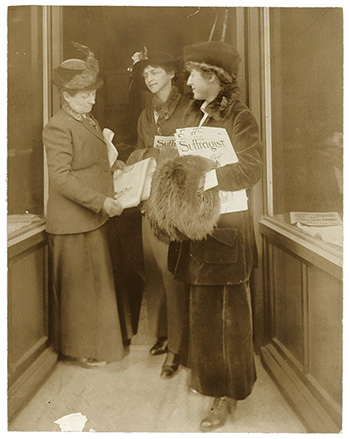 Rep. Jeanette Rankin of Montana, left, reading The Suffragist, Washington, ca. 1917-1918. c. 1917-1918. Library of Congress, Washington, D.C.