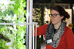 A local branch staff member waters the library's Tower Garden, a self-sustaining, vertical, aeroponic system that has become an unlikely cornerstone of Gwinnett County Public Library's STEM programming.